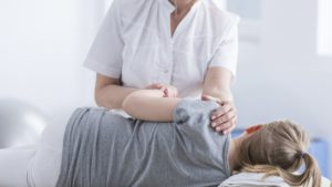 Girl getting chiropractic treatment